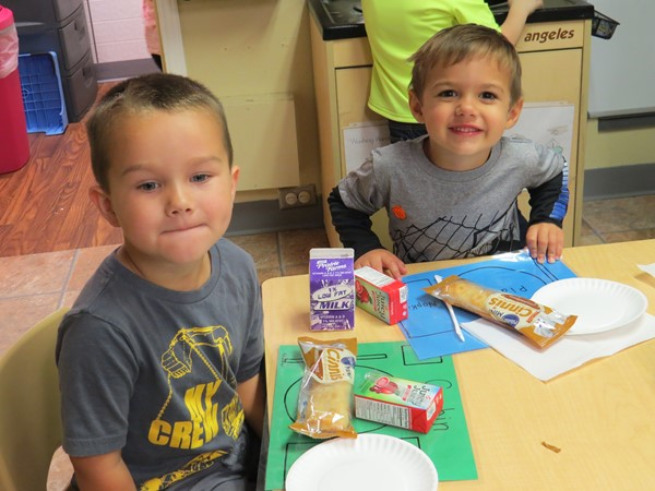 Preschool/Head Start students enjoying snack time