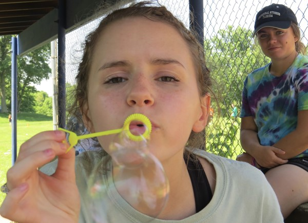 Student blowing bubbles at track and field day