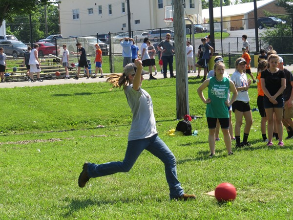 Students playing kickball