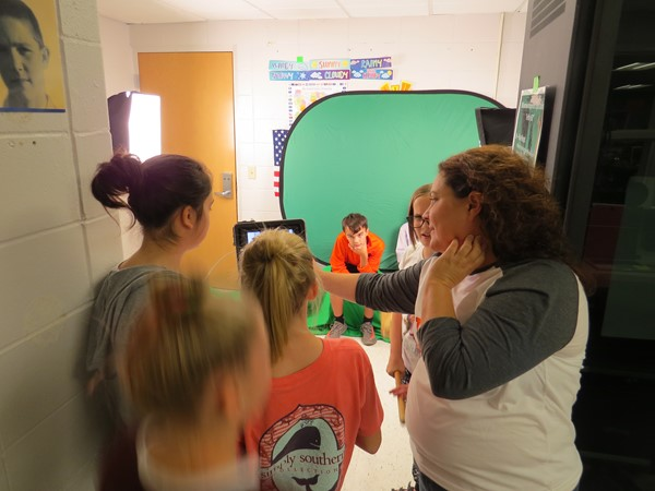 JR high students filming with the portable green screen
