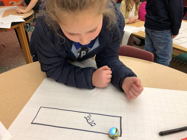 4th graders explored the difference between area and perimeter during a math lesson with Ozobots.