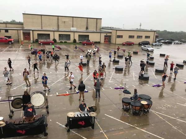 Band of Spirit practicing in the rain