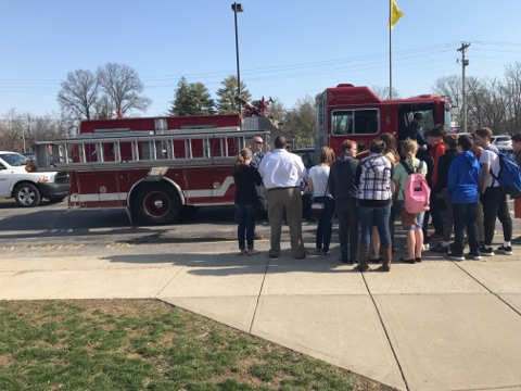 Students on career day with a firefighter