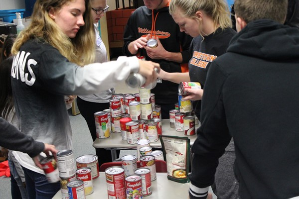 Student Council members sorting canned goods for the food drive