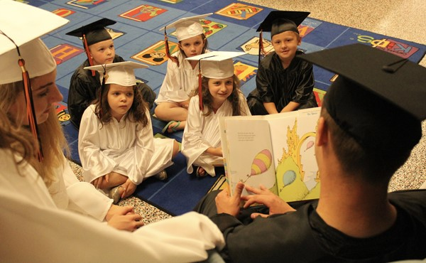 Kindergarten graduates are treated to a story by some of our seniors