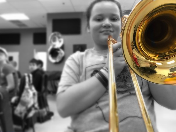 A middle school student learns the basics in beginning band.